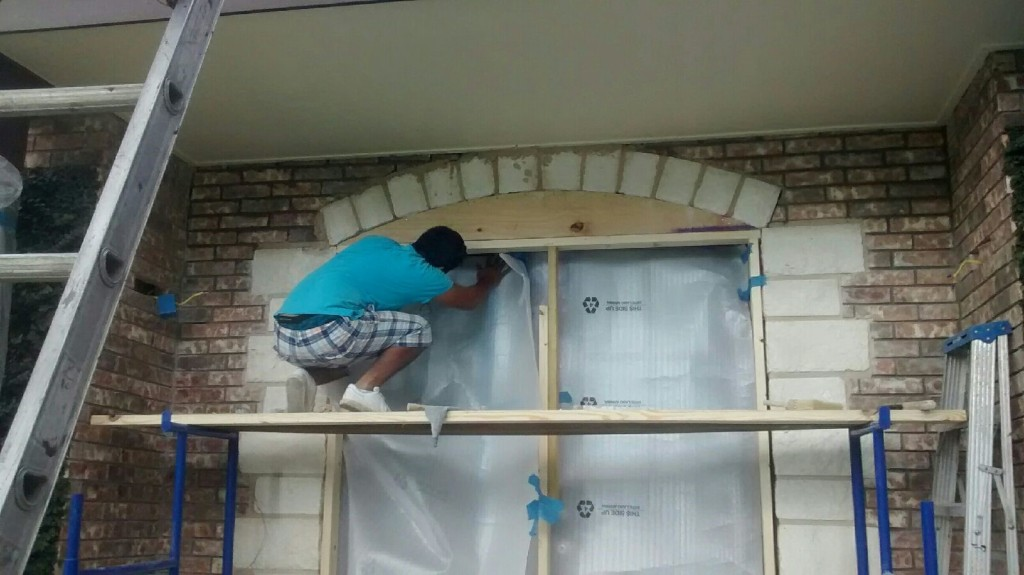 Our master craftsman carefully remove the windows and prepare doorframe