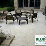 Stone patio with new furniture and firepit
